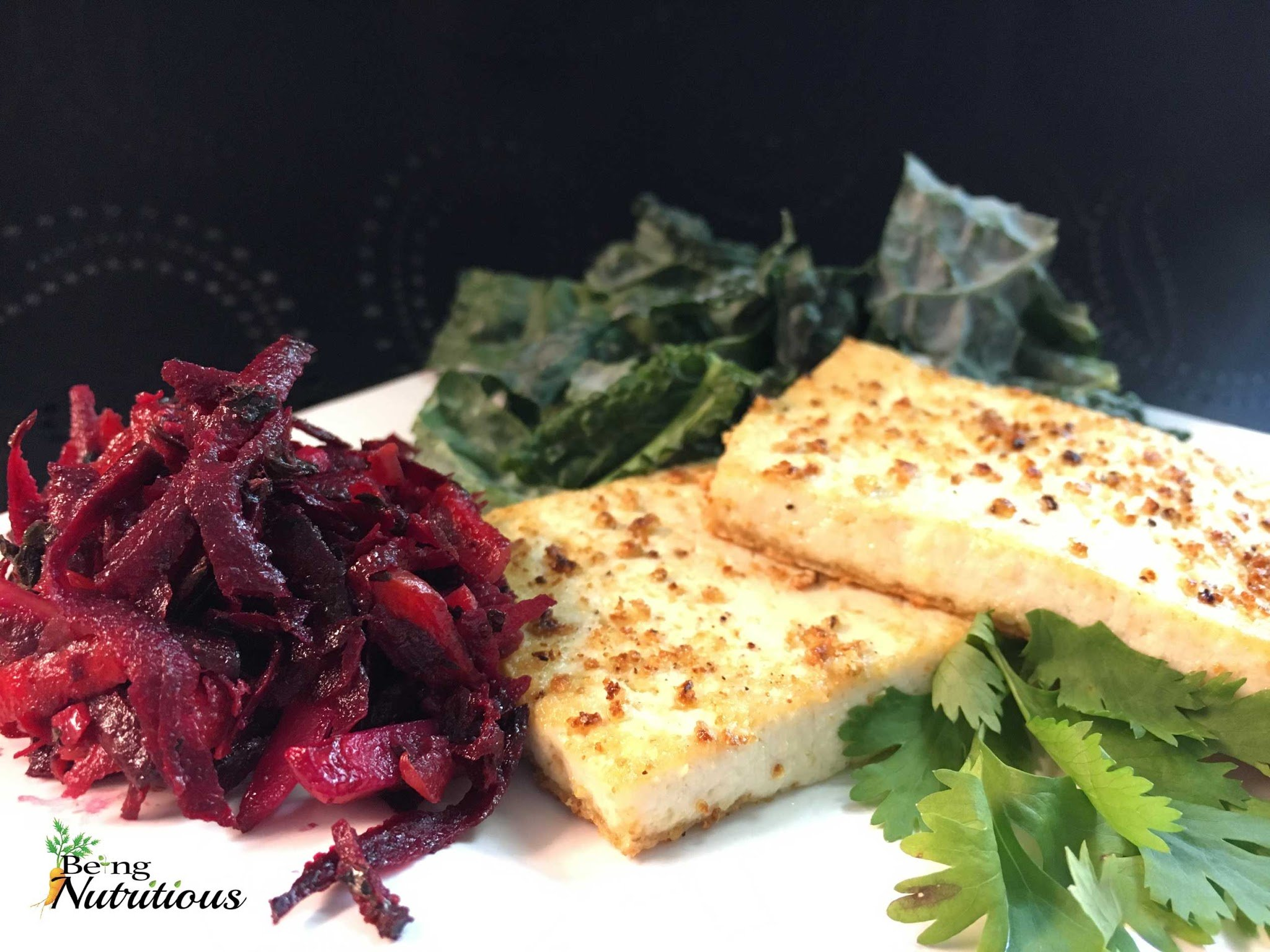 Lemon Pepper Tofu Fillets with sides of shredded beet salad, and a kale salad.