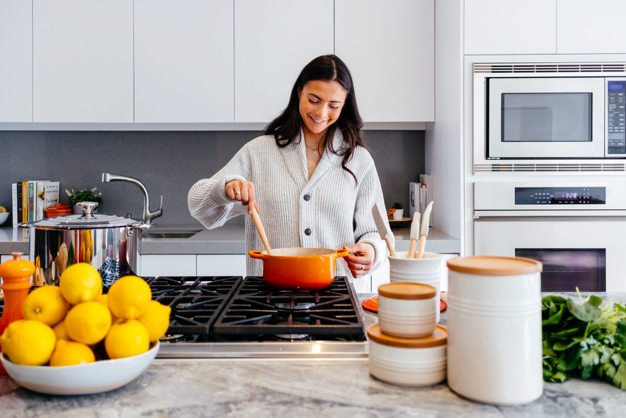 woman cooking in heart healthy kitchen