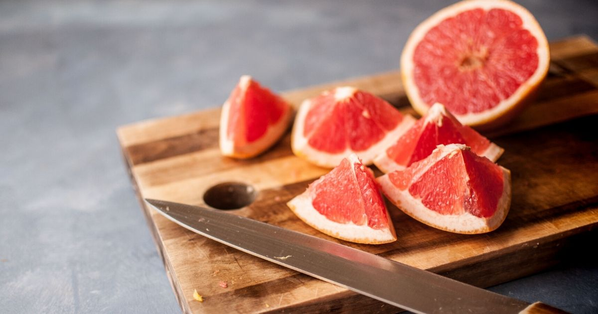 Cut grapefruit on a cutting board