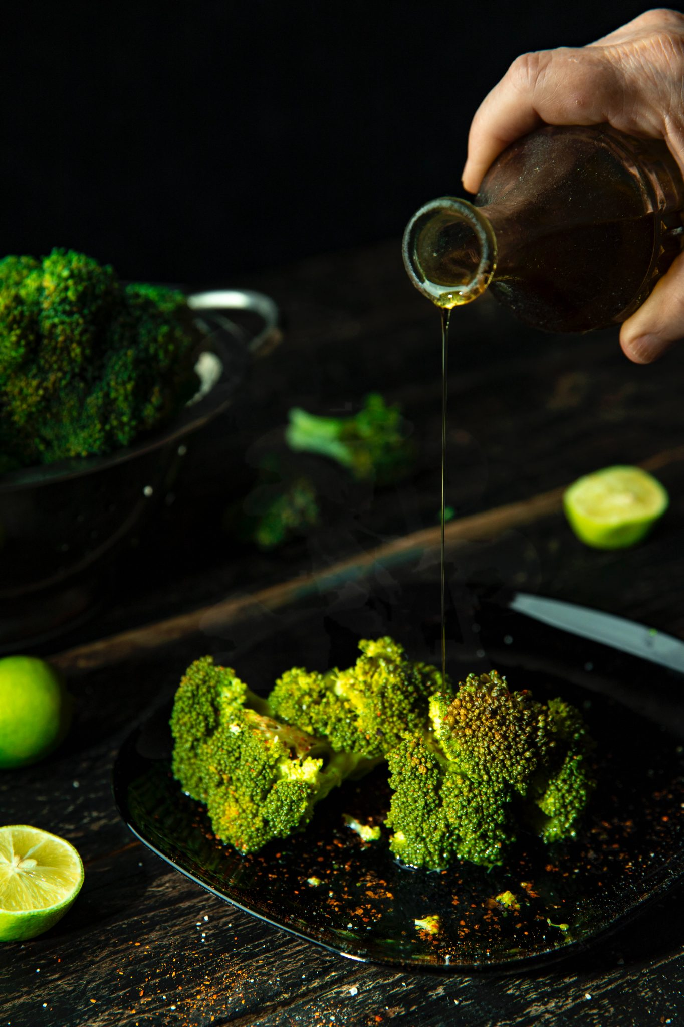 Oil being drizzled on broccoli