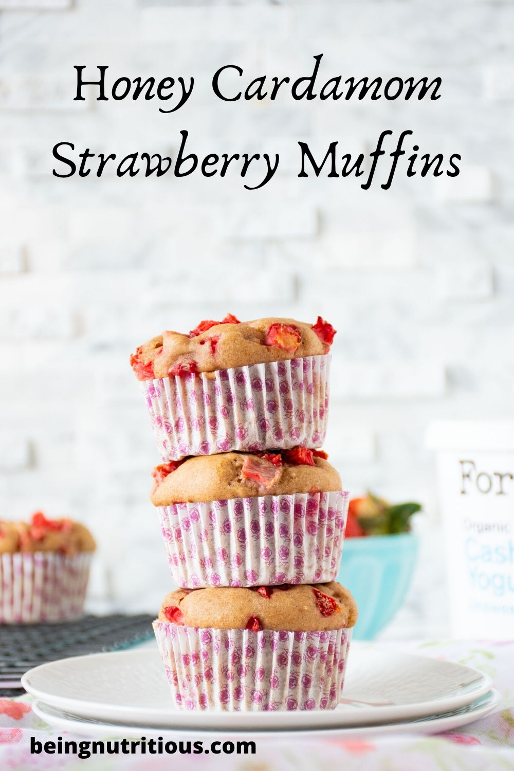 "Stack of 3 strawberry muffins with the words ""Honey Cardamom Strawberry Muffins"" written above"