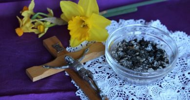 Daffodils, a crucifix, and a bowl of ashes on a purple background