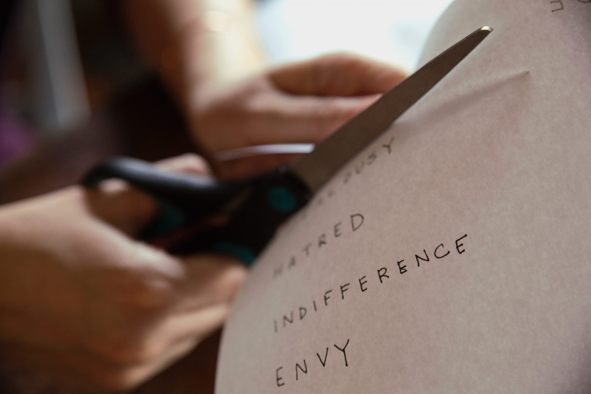 "What to give up for Lent: Someone cutting up a paper that reads ""Hatred"" ""Indifference"" and ""Envy"""