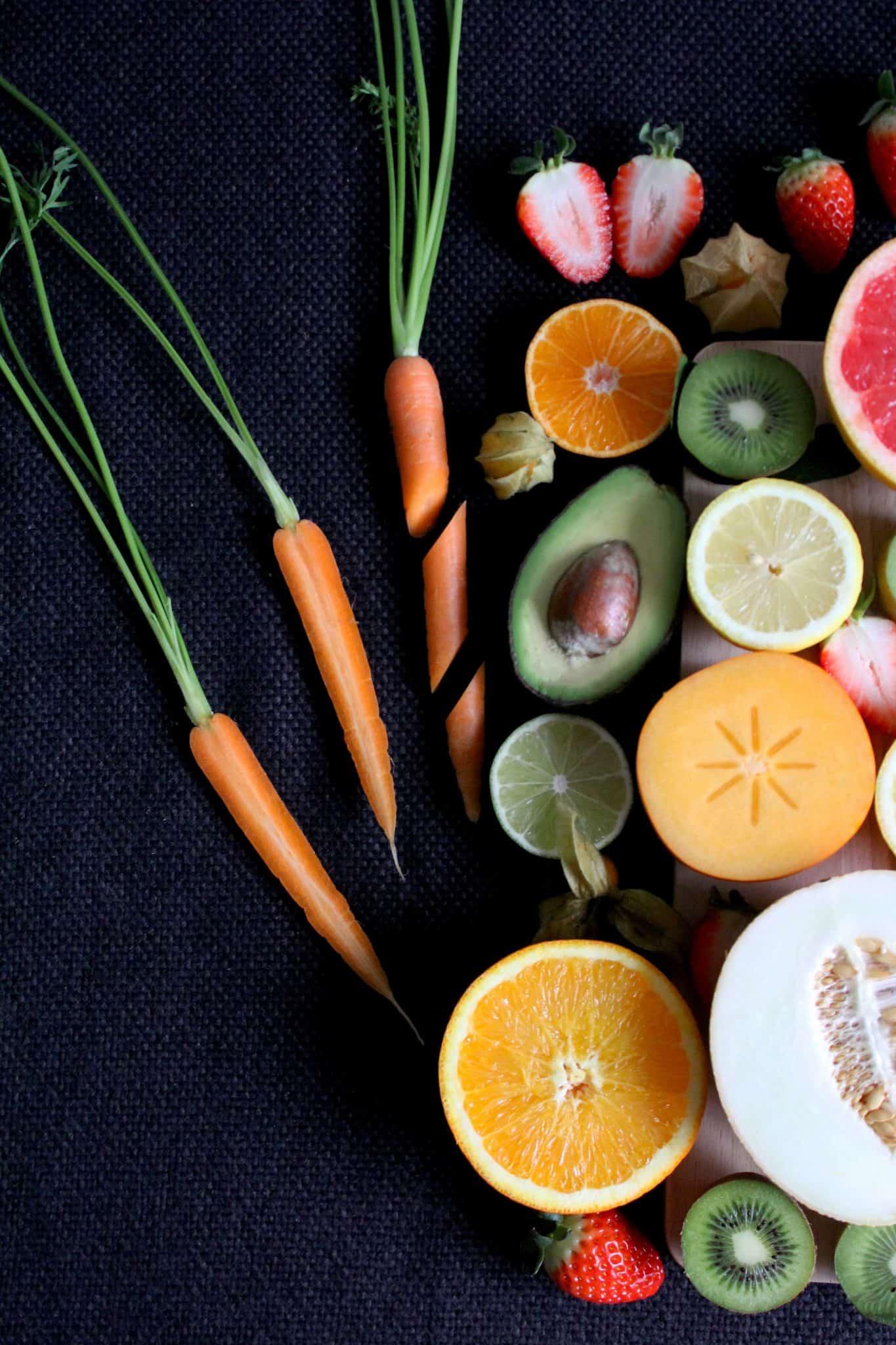 Fruit and vegetables, sliced, on a dark background