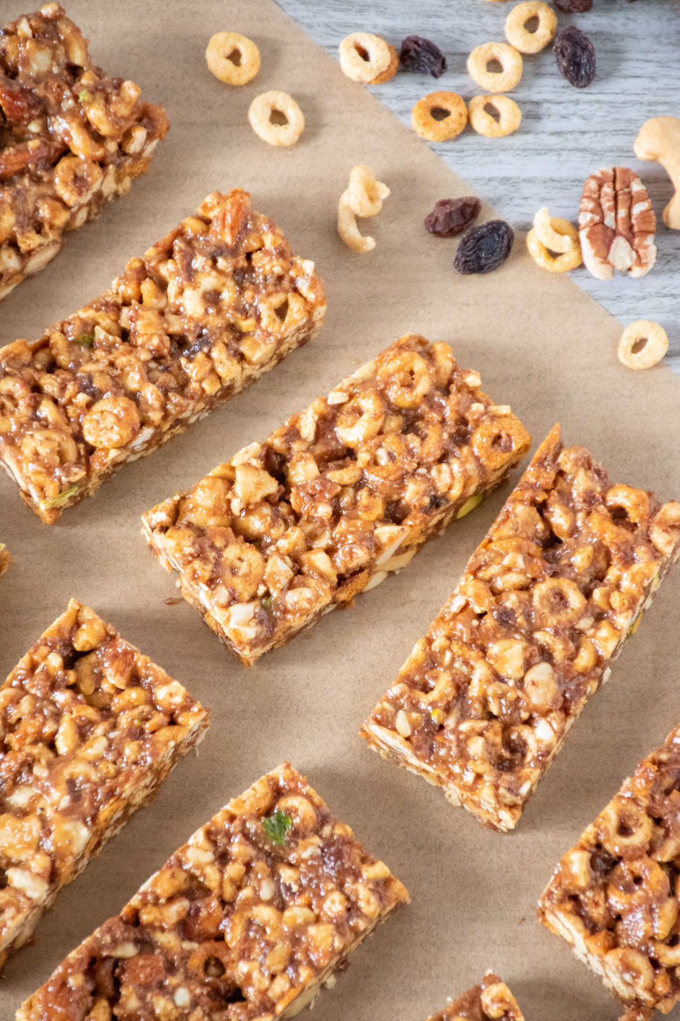 Overhead view of cereal bars on parchment paper.