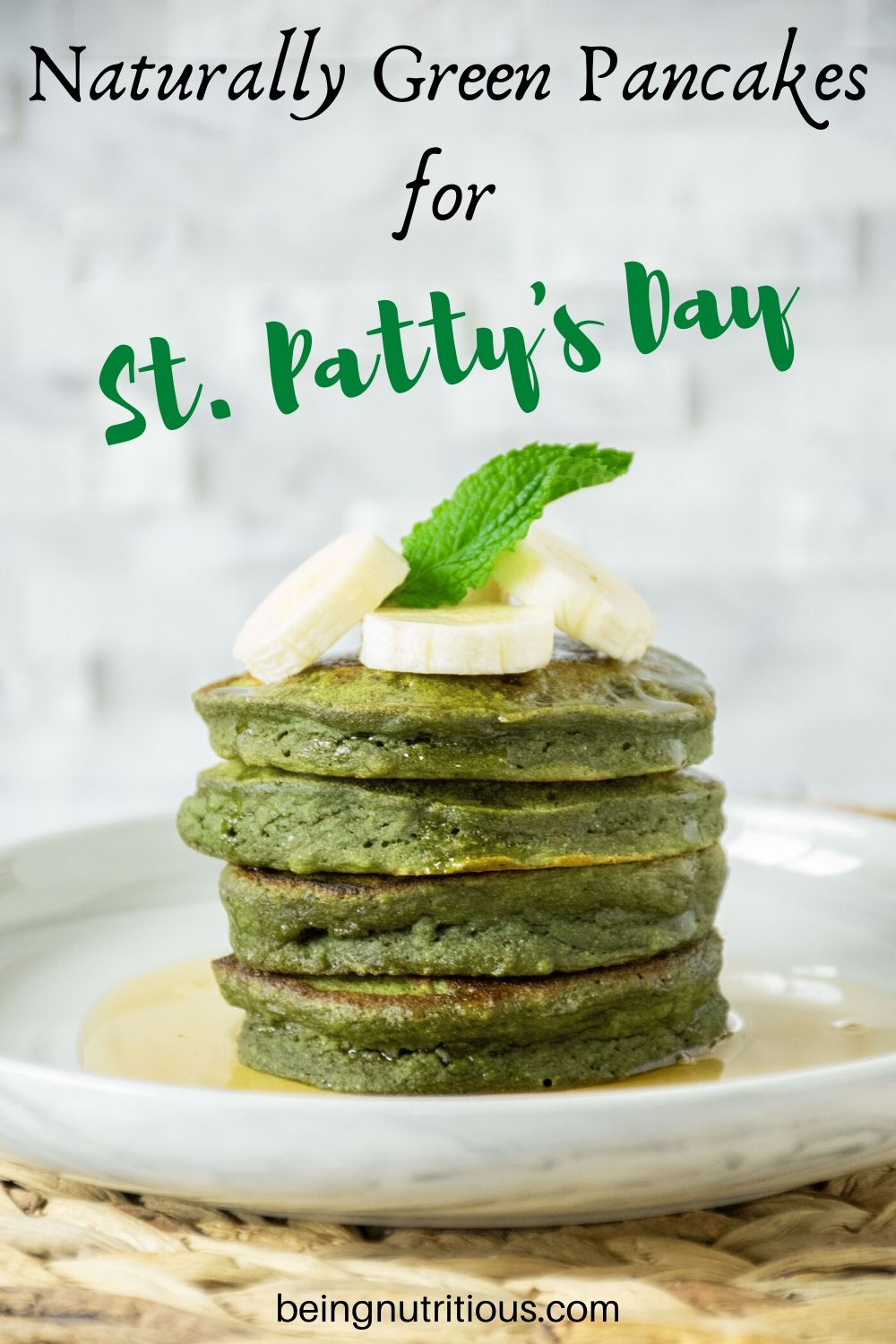 Stack of 4 Banana Mint Pancakes with banana slices and a mint leaf on top.