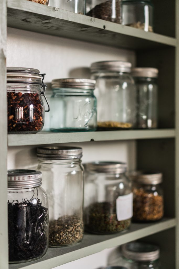 Inside of a pantry with jars of spices
