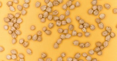Dry chickpeas on a field of orange