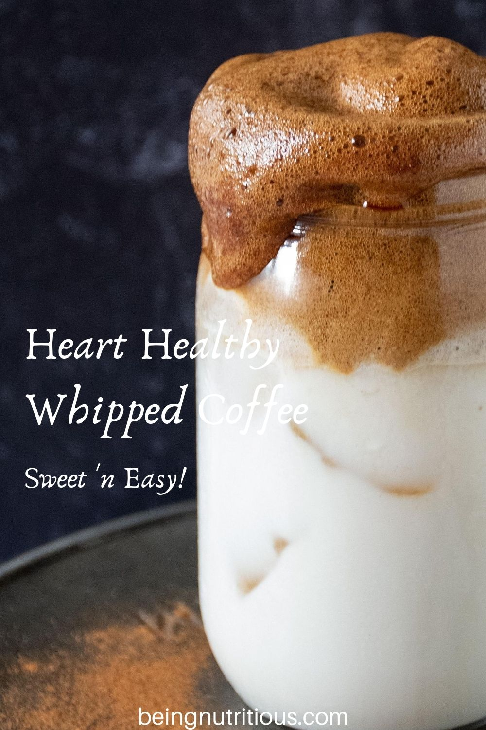 "Close up of whipped coffee over iced almond milk in a Mason jar with text overlay: ""Heart Healthy Whipped Coffee, sweet 'n easy"""