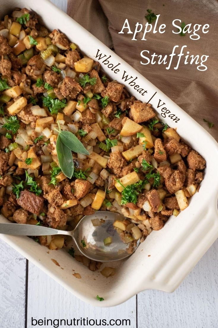Large casserole dish with stuffing, and a spoon. Text overlay: Apple Sage Stuffing, whole wheat, vegan.