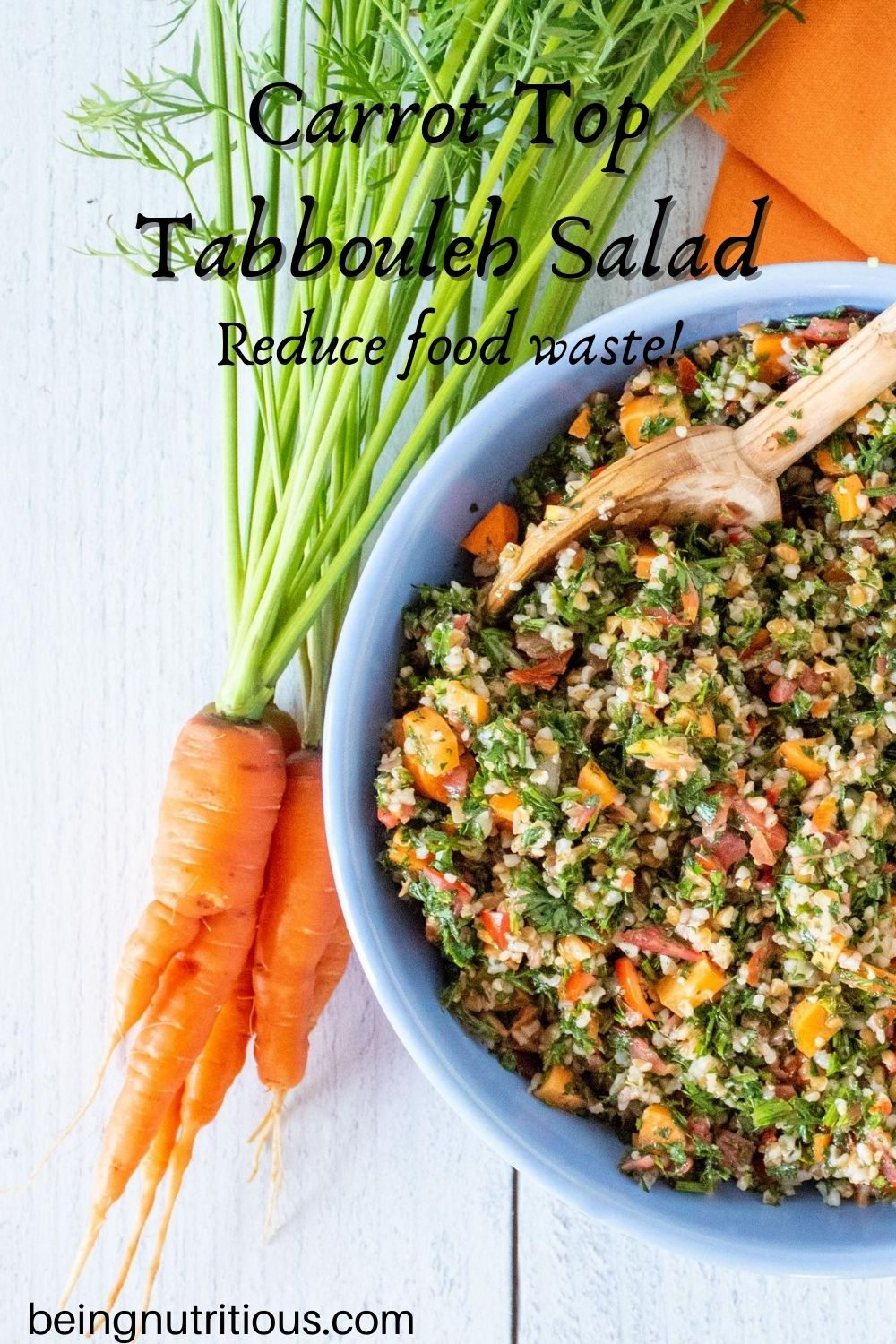 Overhead shot of carrot top tabbouleh in a blue bowl, half of the bowl shown, with a bunch of carrots with the tops still attached lying beside the bowl. Text overlay: Carrot top tabbouleh salad; Reduce food waste!