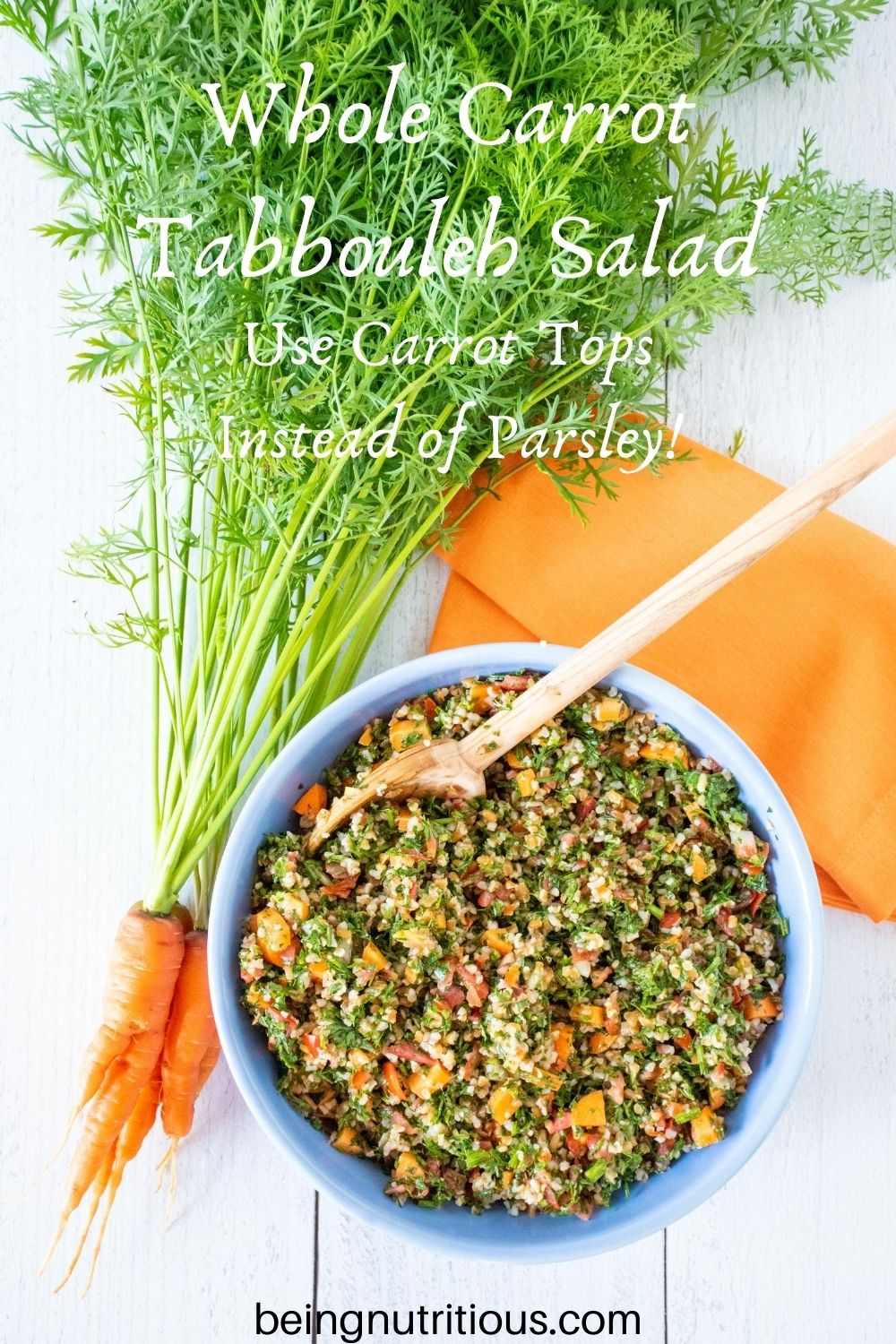 Overhead shot of tabbouleh in a blue bowl, with a bunch of carrots with the tops still attached lying beside the bowl. Text overlay: Whole Carrot Tabbouleh Salad; Use carrot tops instead of parsley!