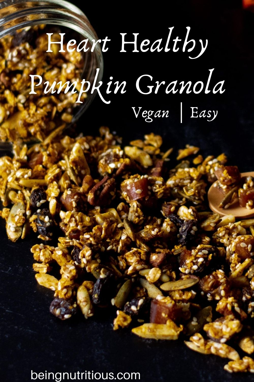 Granola spilling out of a Mason jar on a black background with text overlay: Heart Healthy Pumpkin Granola, vegan, easy.