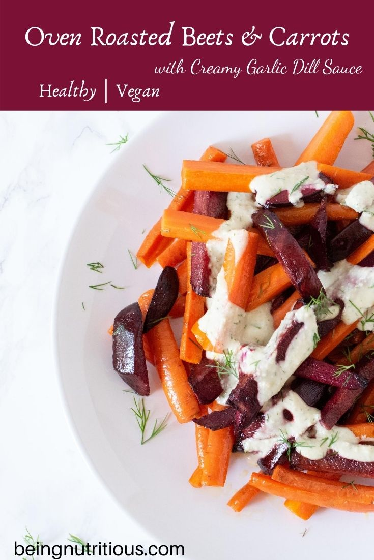 Roasted beets and carrots, cut into sticks, drizzled with garlic dill sauce on a white plate. Text overlay on purple field: Oven Roasted Beets and Carrots with Creamy Garlic Dill Sauce, healthy, vegan.