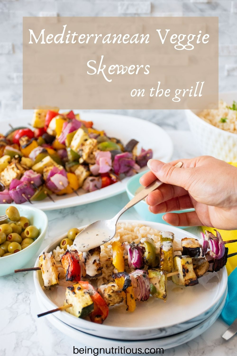 Plate with 2 veggie skewers and rice, with marinade being drizzled over. Text overlay: Mediterranean Veggie Skewers on the grill.