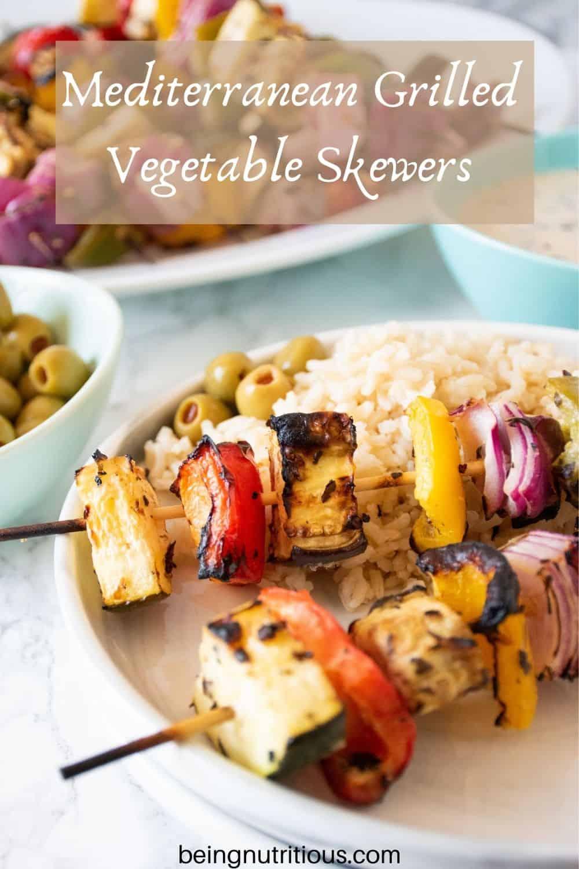 Plate with 2 veggie skewers and rice. Text overlay: Mediterranean Grilled Vegetable Skewers.