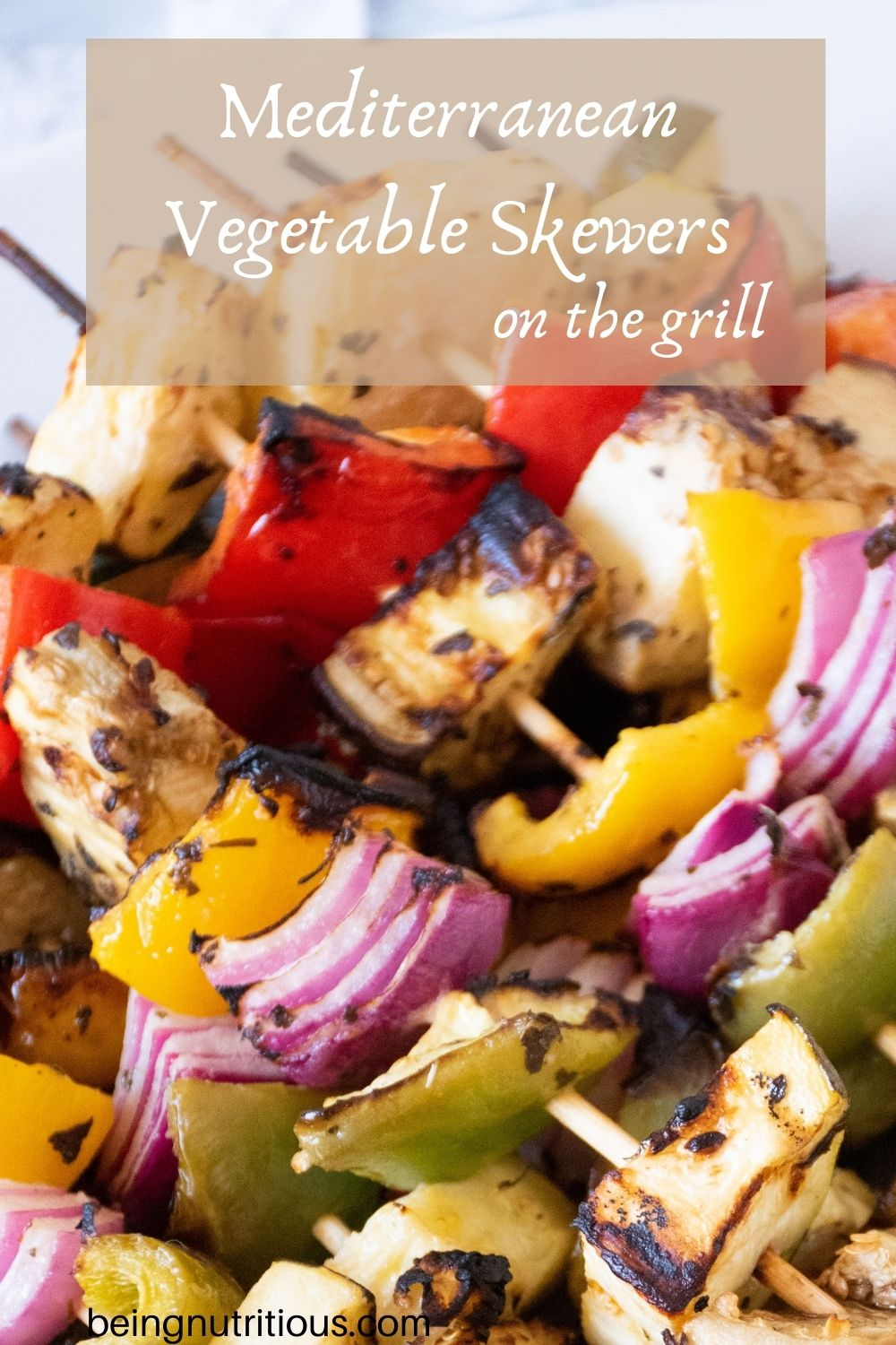 Close up of vegetable kabobs. Text overlay: Mediterranean Vegetable Skewers on the grill.