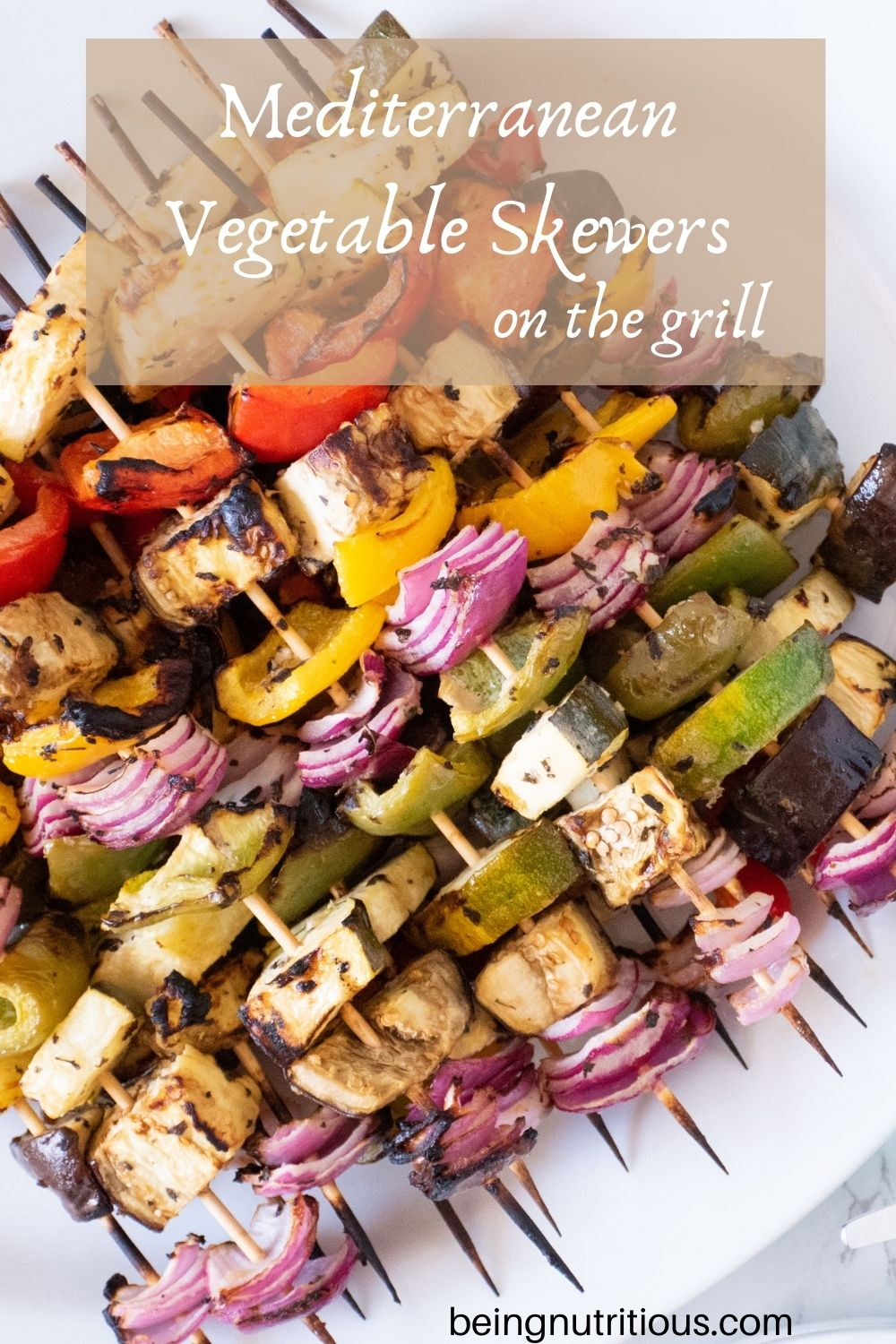 Serving platter with vegetable skewers piled on. Text overlay: Mediterranean Vegetable Skewers on the Grill.