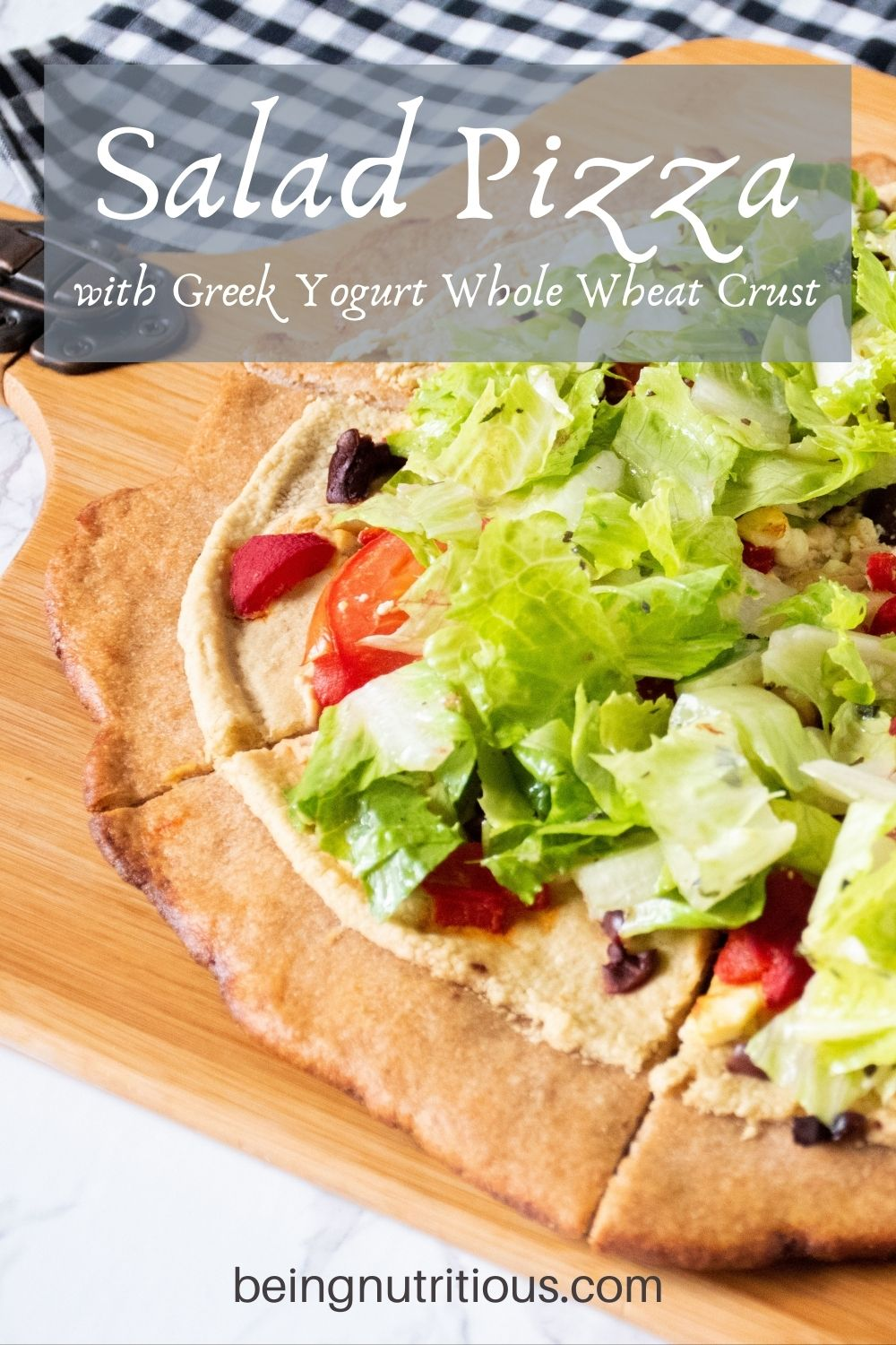 Pizza on a peel, with whole wheat crust, topped with salad. Text overlay: Salad Pizza with Greek Yogurt Whole Wheat Crust.