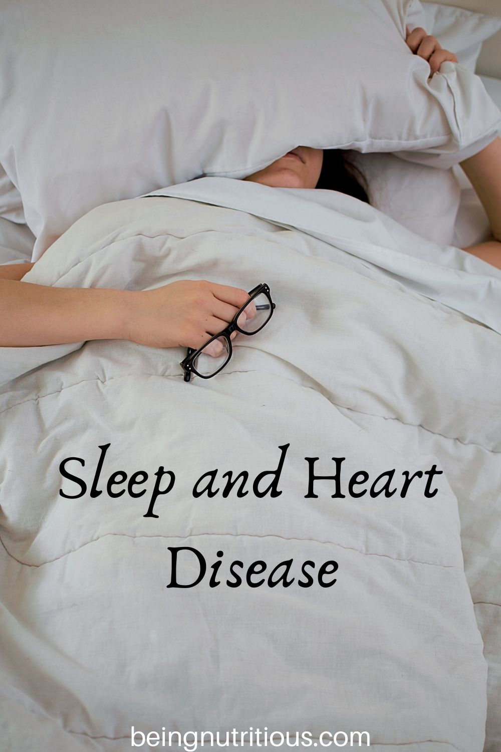 Woman sleeping under her covers with text overlay: Sleep and Heart Health.