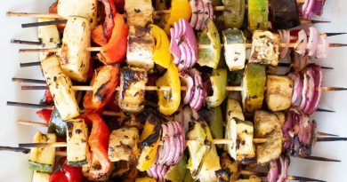 Serving platter with vegetable skewers piled on.