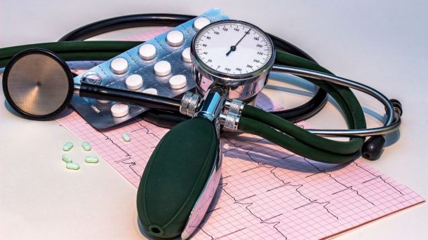 blood pressure cuff with ekg results and pills
