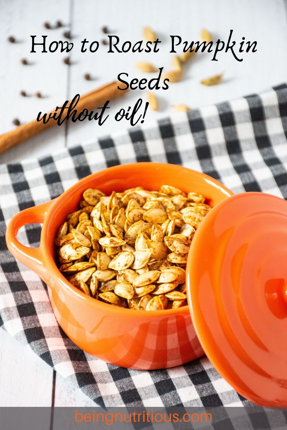 Small pot filled with roasted pumpkin seeds. Text overlay: How to roast pumpkin seeds without oil