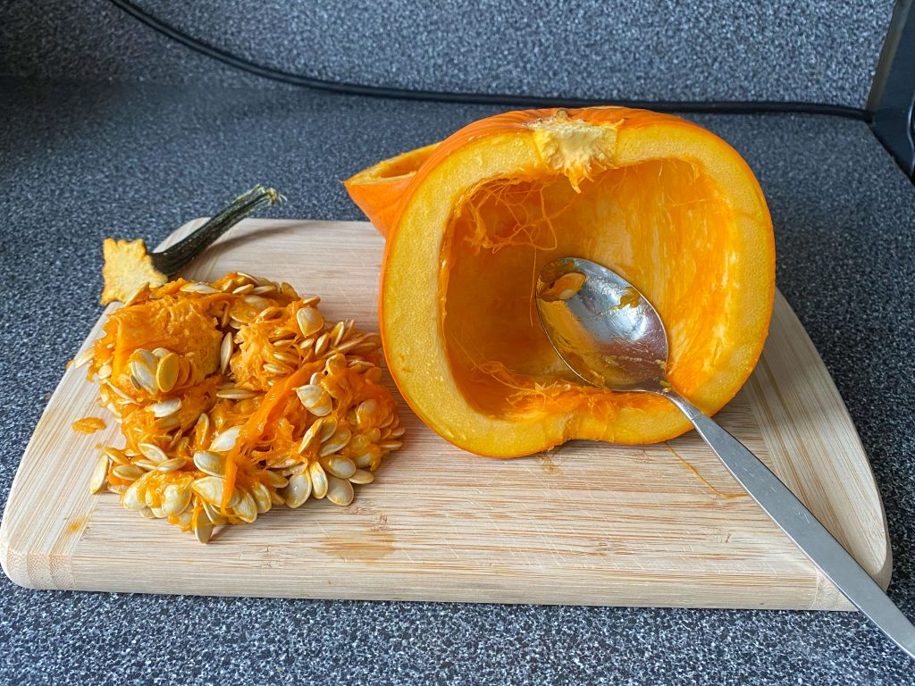 Pumpkin cut in half with seeds removed.