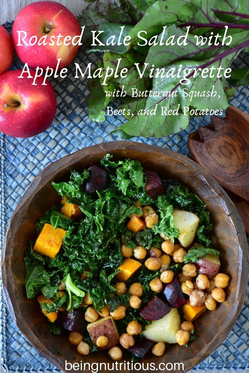 Overhead shot of kale salad in a wooden bowl. Text overlay: Roasted Kale Salad with Apple Maple Vinaigrette, with butternut squash, beets, and red potatoes.