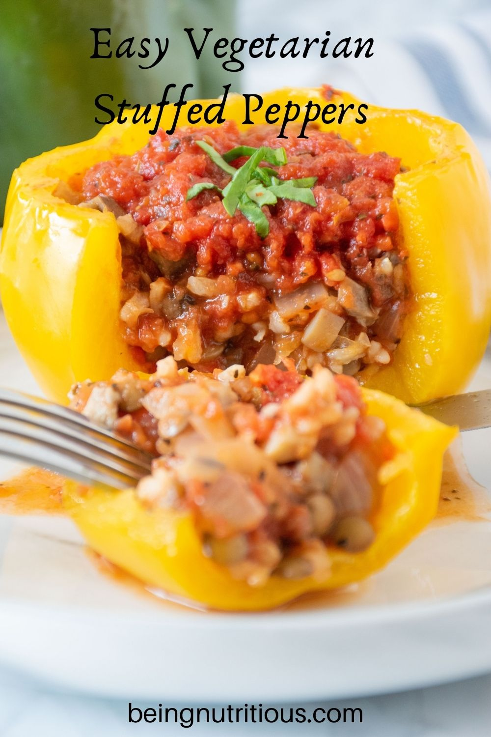A yellow stuffed pepper, side cut open to reveal stuffing, on a plate. Text overlay: Easy vegetarian stuffed peppers.