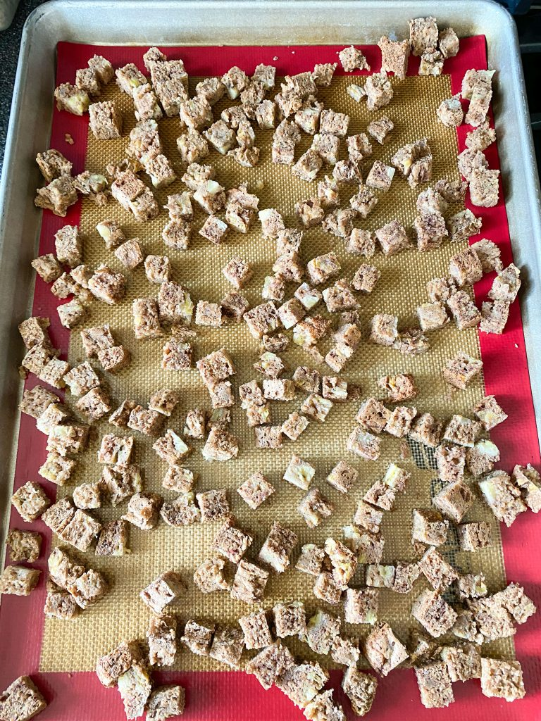 Cubes of bread on cookie sheet